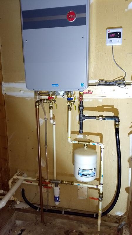rheem indoor tankless water heater. installation, replacing an old lp tank water heater. rheem indoor tankless heater