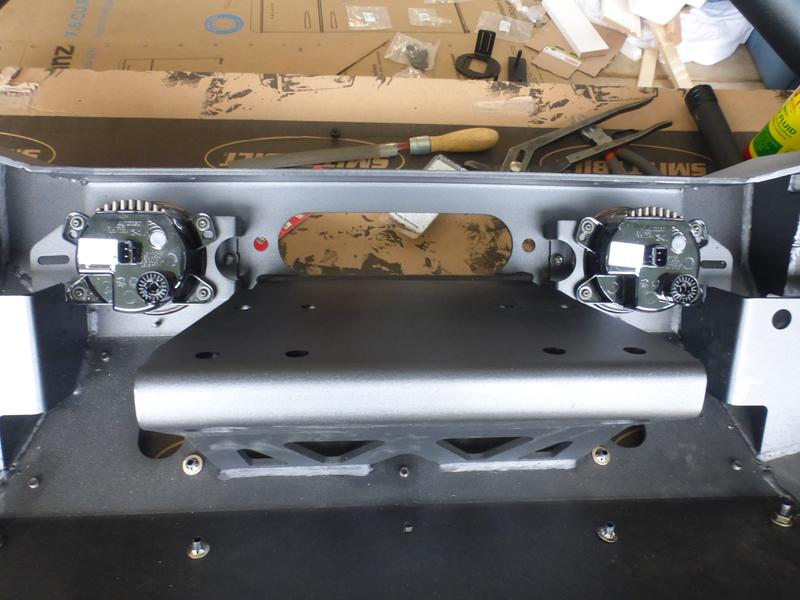 Fog lights relative to winch mounting plate.