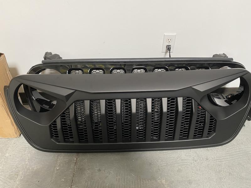Compare of the new DV8 grill to the stock jeep grill. Looks too short but it's not.