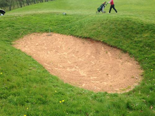 No sand in bunkers.