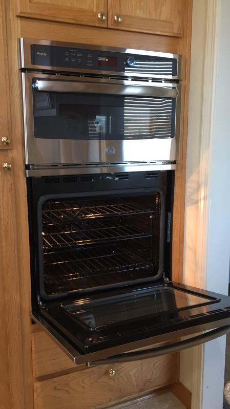 Shiny self cleaning lower oven with gliding tray!