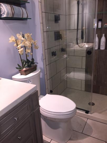 The profile is slimmer than a standard toiket which allowed more space between the vanity and shower