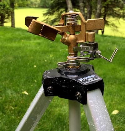 The sprinkler with the stop arm disengaged to allow for a full 360° rotation