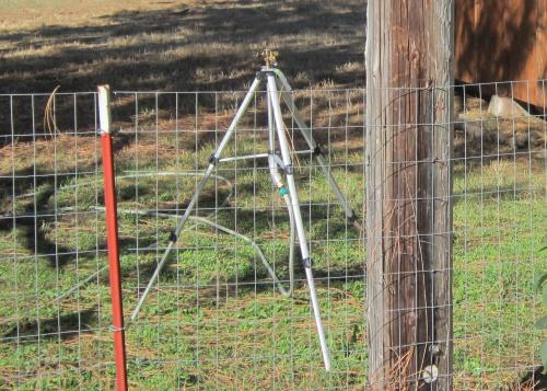 can be extended tall enough so it reaches over fence and shrubs