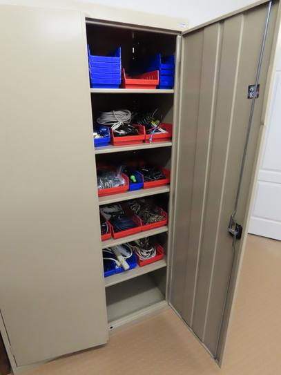 Bins in cabinet