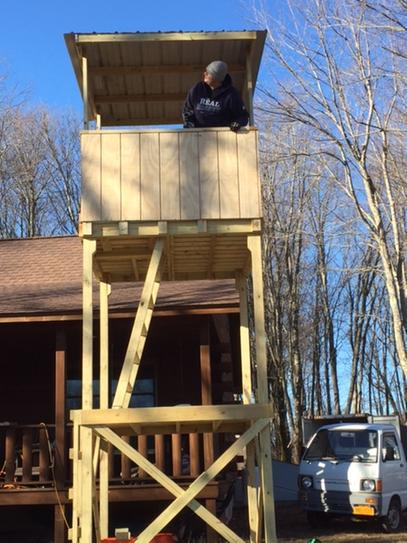 My Nephew in the two story tree stand we build as a family. We used the NuMax nail gun and now we just need to see some deer.
