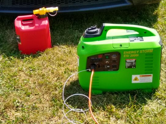 Generator powering battery charging complex at model airplane field