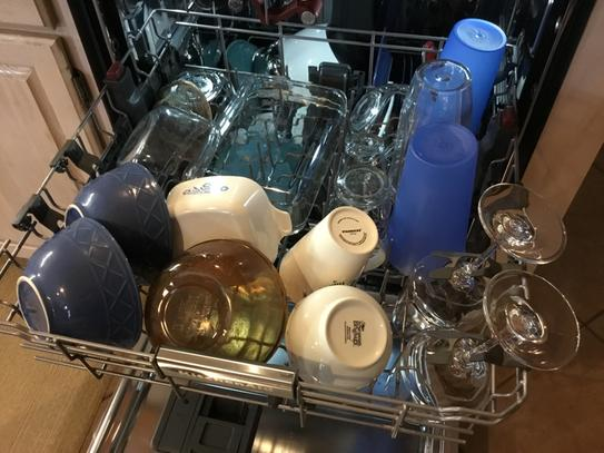 Deep middle shelf can hold extra large goblets and tall wine glasses