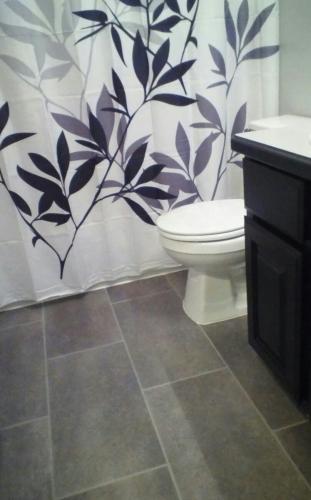 TrafficMASTER Ceramica Coastal Grey In X In Vinyl Tile - 30 sq ft bathroom