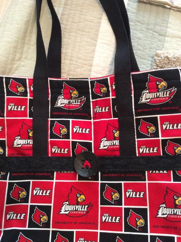 7a45de7c University of Louisville Cardinals Fleece Fabric -Allover