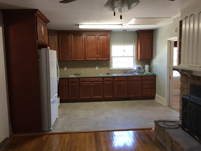 Renovated Kitchen With Shenandoah Cabinetry.